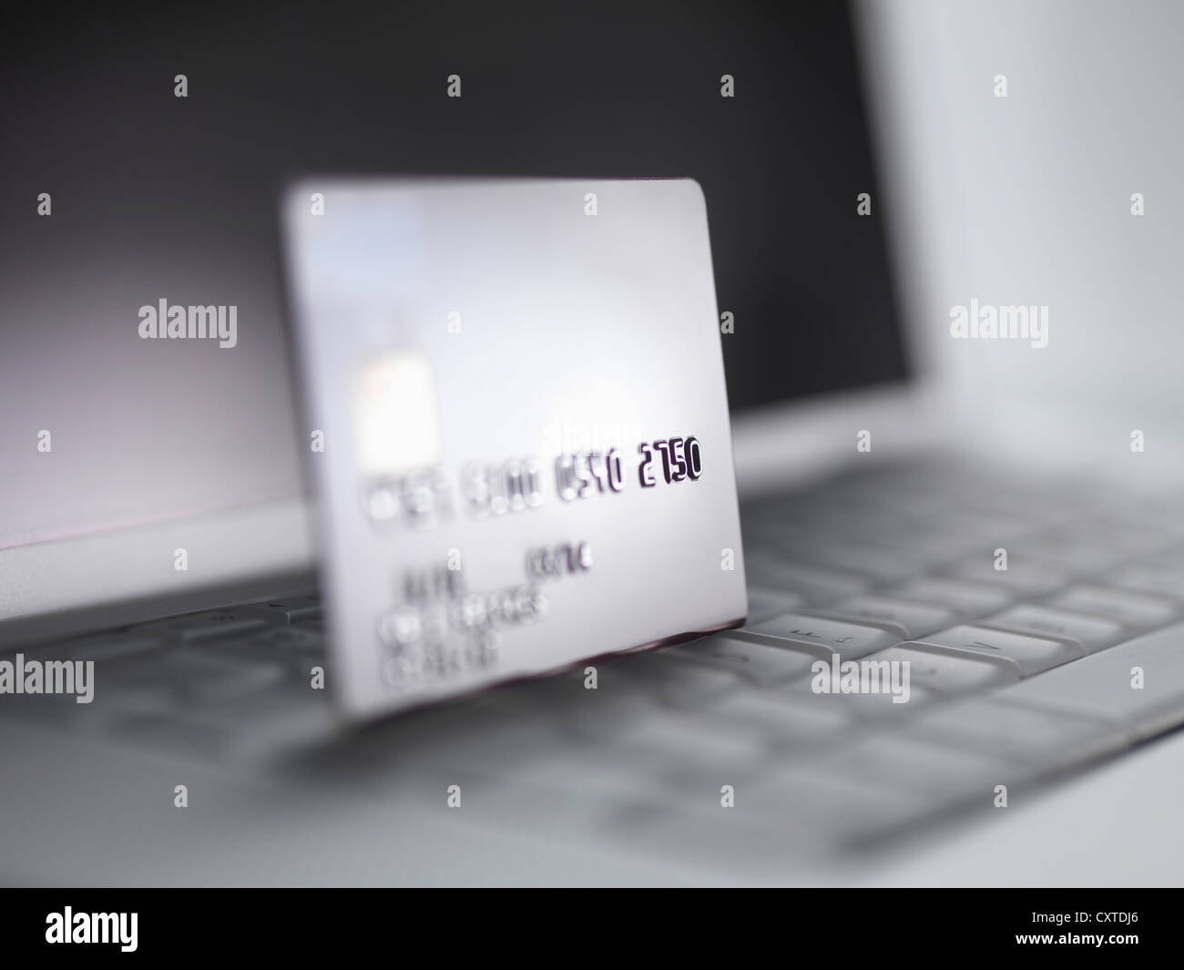 Close up of credit card on keyboard - Stock Image