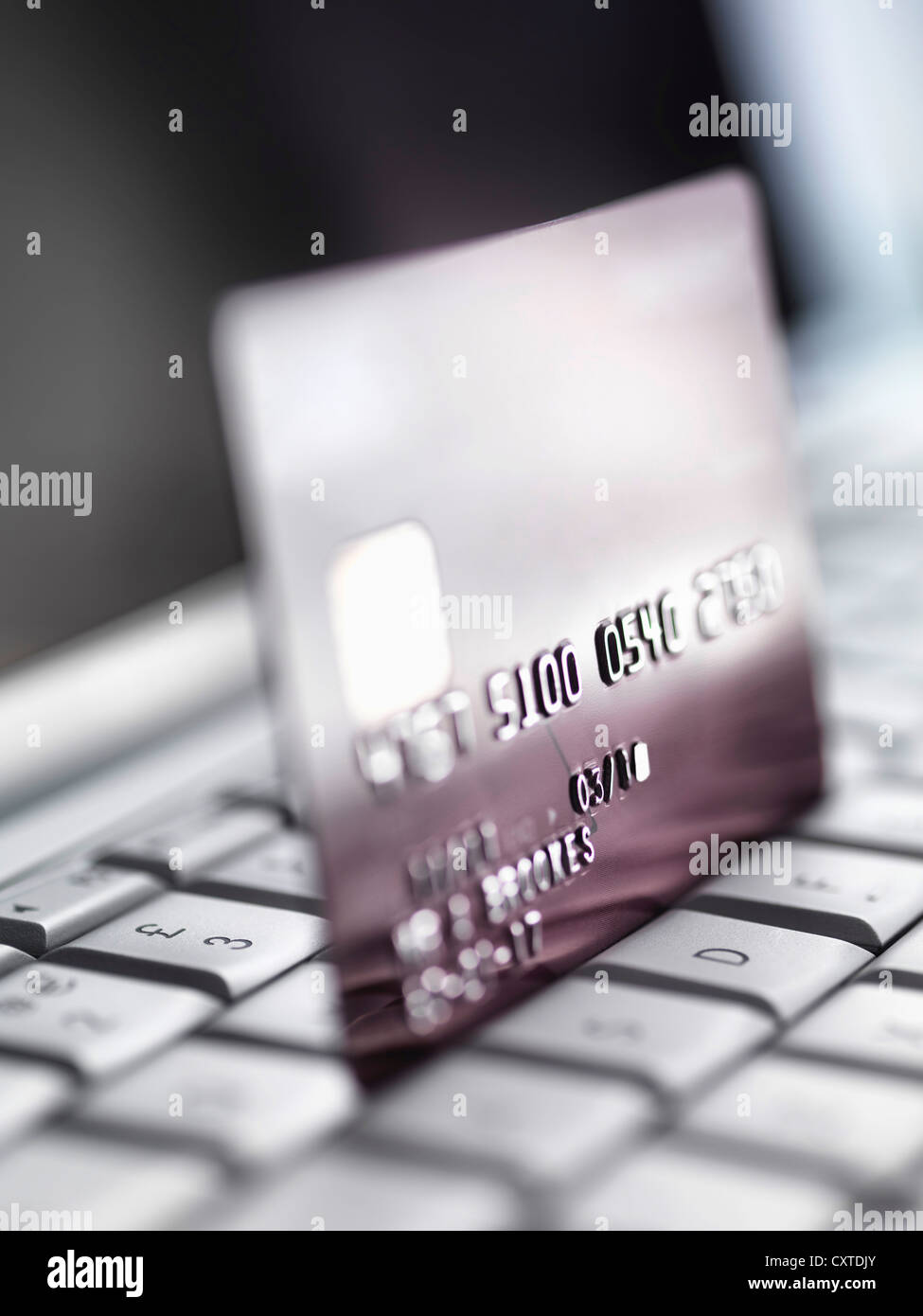 Close up of credit card on keyboard Stock Photo