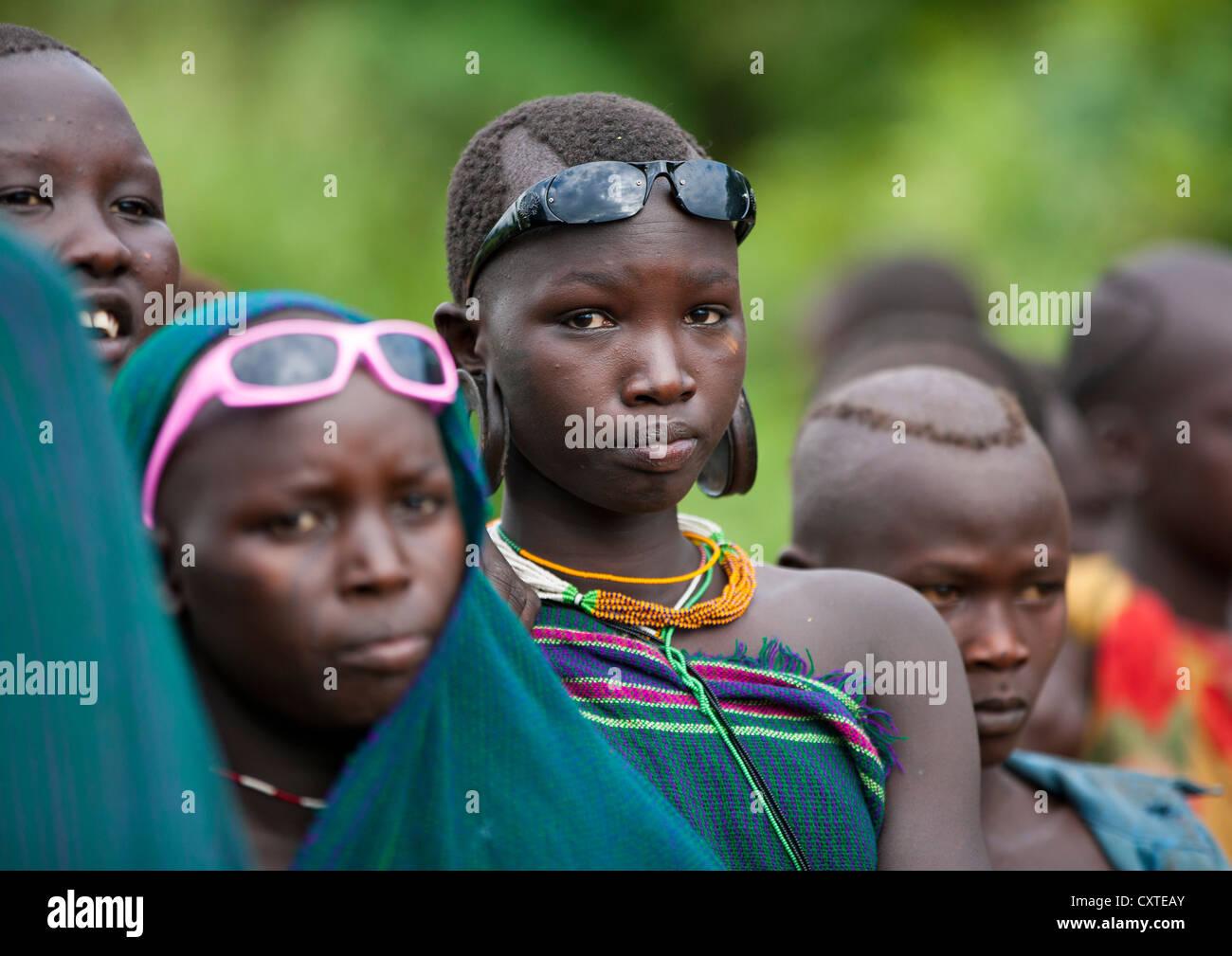 Suri Tribe Girls At A ceremony organized by the government, Kibish, Omo Valley, Ethiopia Stock Photo