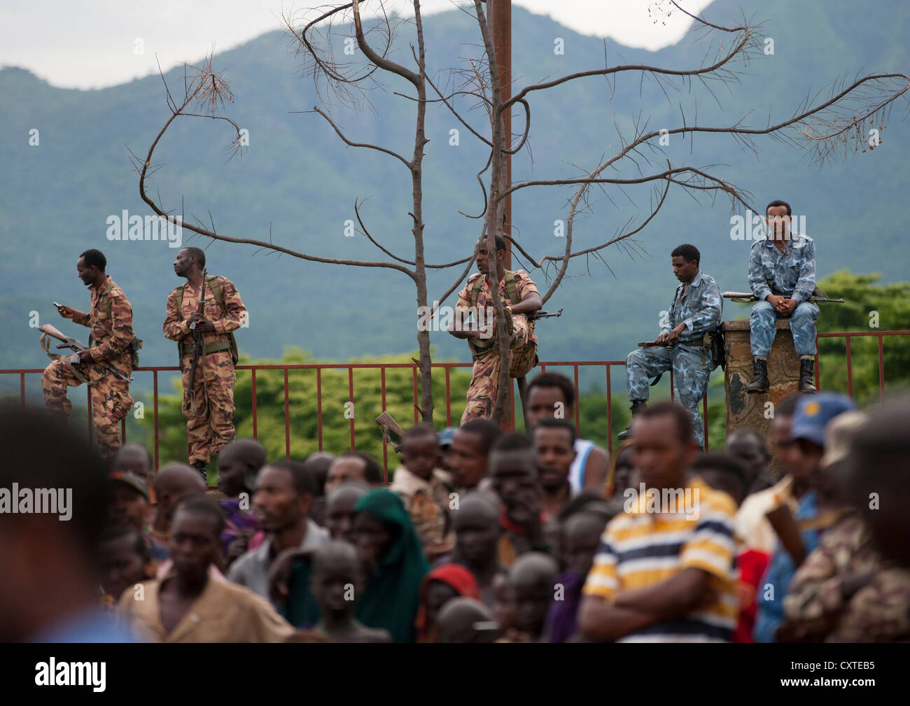 Ethiopian Army Monitoring Suri People During A ceremony organized by the government, Kibish, Omo Valley, Ethiopia Stock Photo