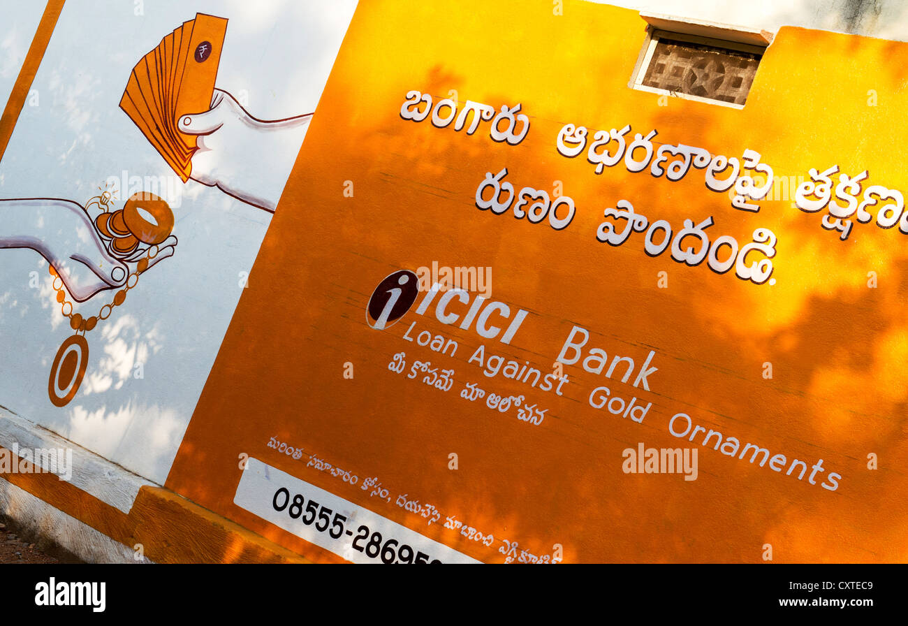 Indian gold loan advertisement painted on a house wall. Andhra Pradesh, India Stock Photo