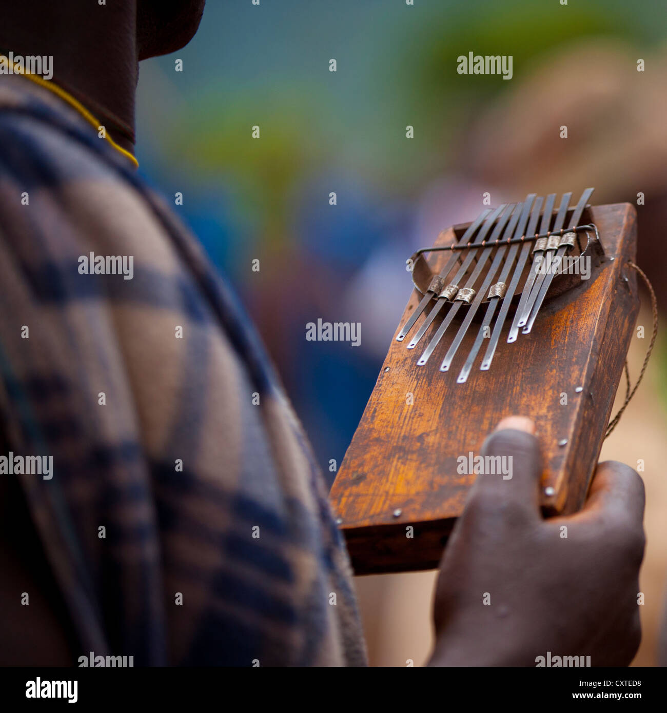 Detail Of A Suri Tribe Person Holding A Kalimba At A Ceremony Organized By The Government, Kibish, Omo Valley, Ethiopia Stock Photo