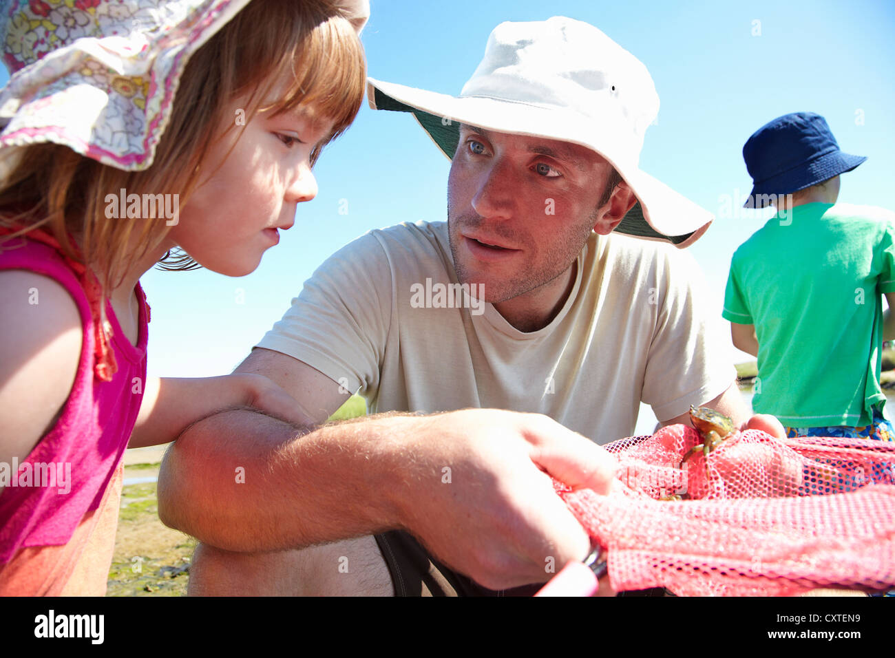 Father and daughter fishing with nets - Stock Image