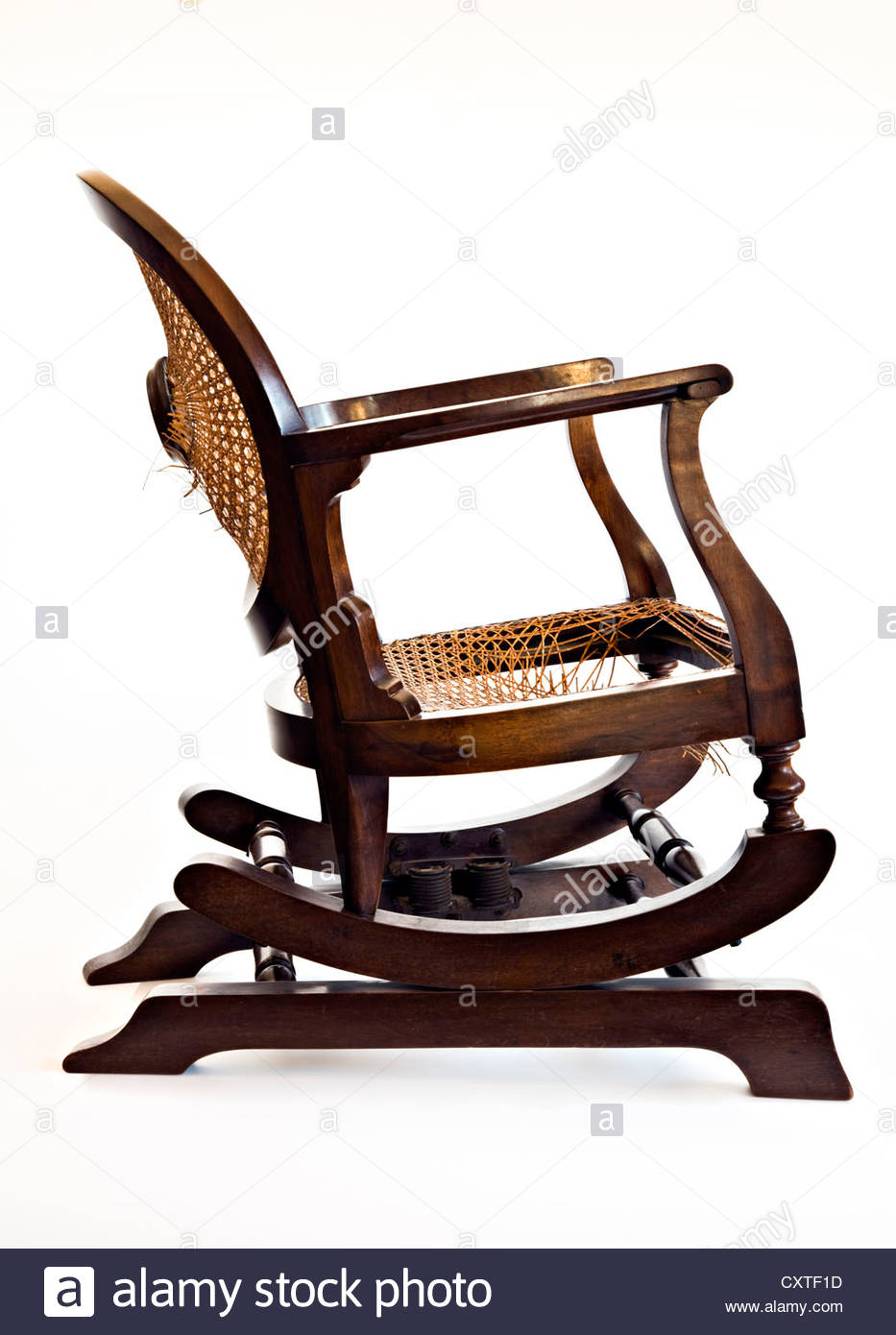 Side view of old wooden rocking chair on white background ...