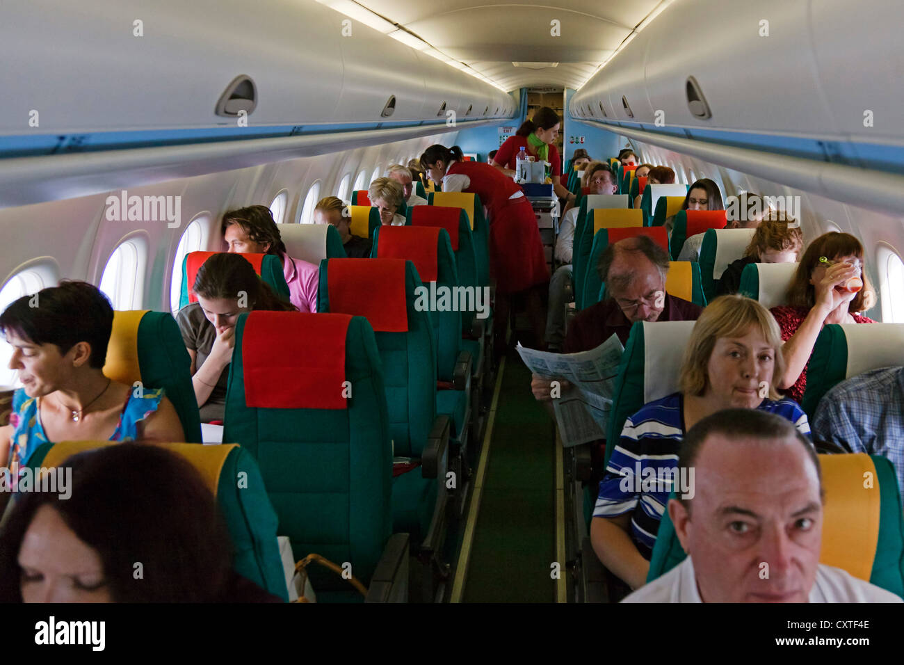 Passengers on flight, Austrian Airlines - Stock Image