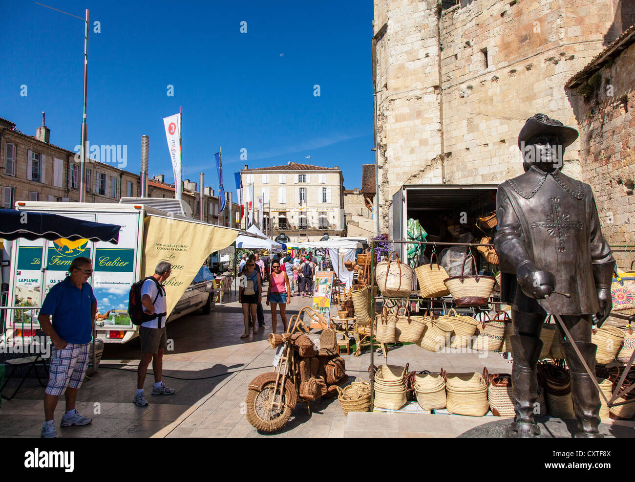 market day with stalls and people in Condom, Gers, Gascony, France - Stock Image