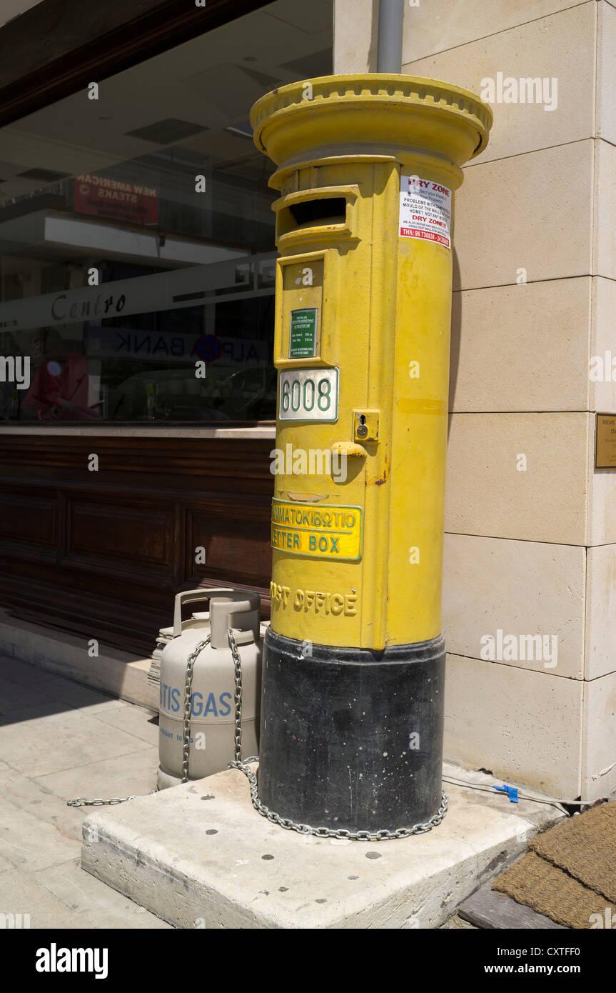 dh Postbox POST CYPRUS Old British yellow pillarbox Stock Photo