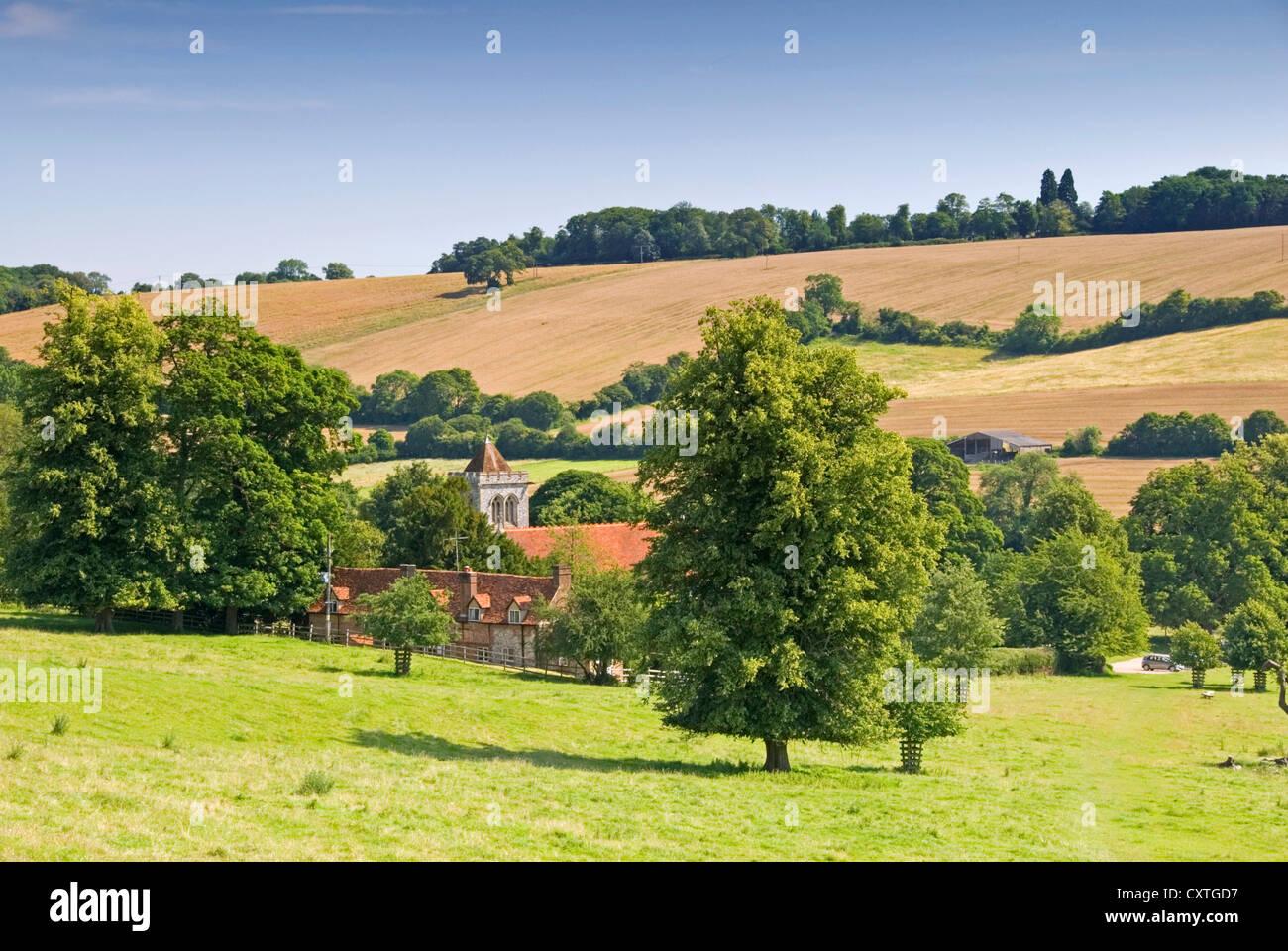 Bucks - Chiltern Hills - Hughenden valley - view to St Michael's church - bright summer sunlight - blue sky - Stock Image