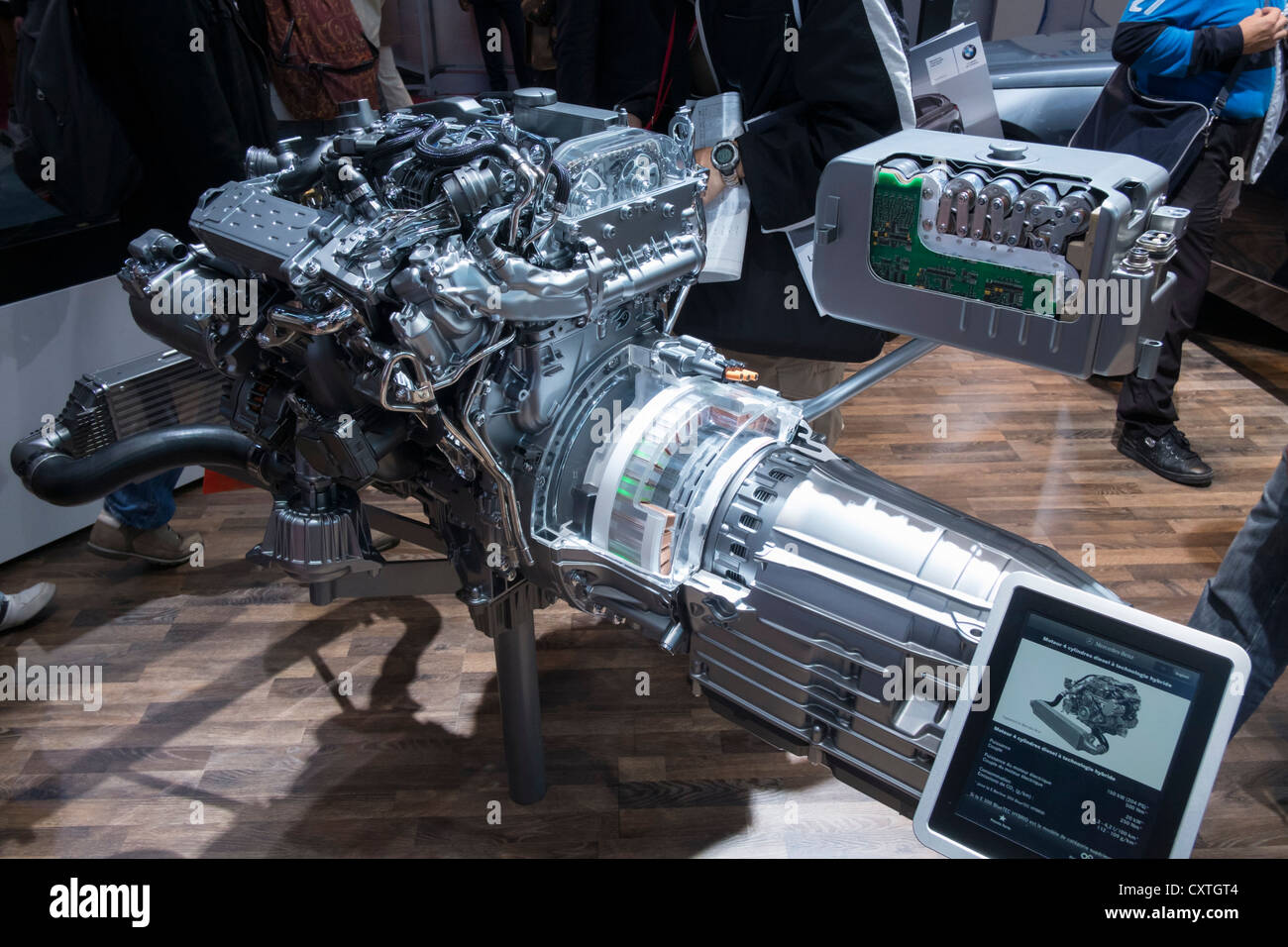 New Mercedes Benz hybrid diesel - electric engine and motor on display at Paris Motor Show 2012 - Stock Image