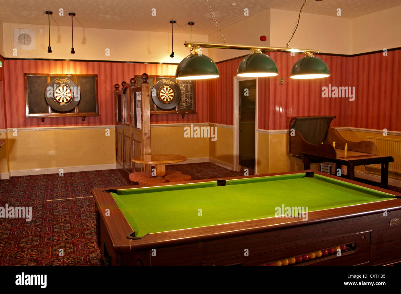The New Market Pub Games Room With Pool Table And Darts Boards Stock