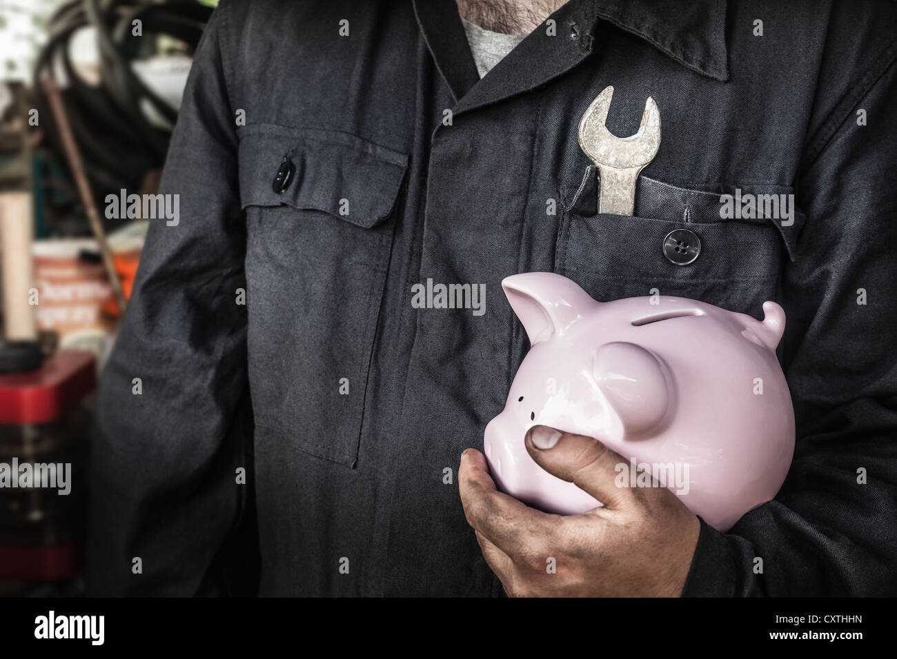 Close up of worker holding piggy bank Stock Photo