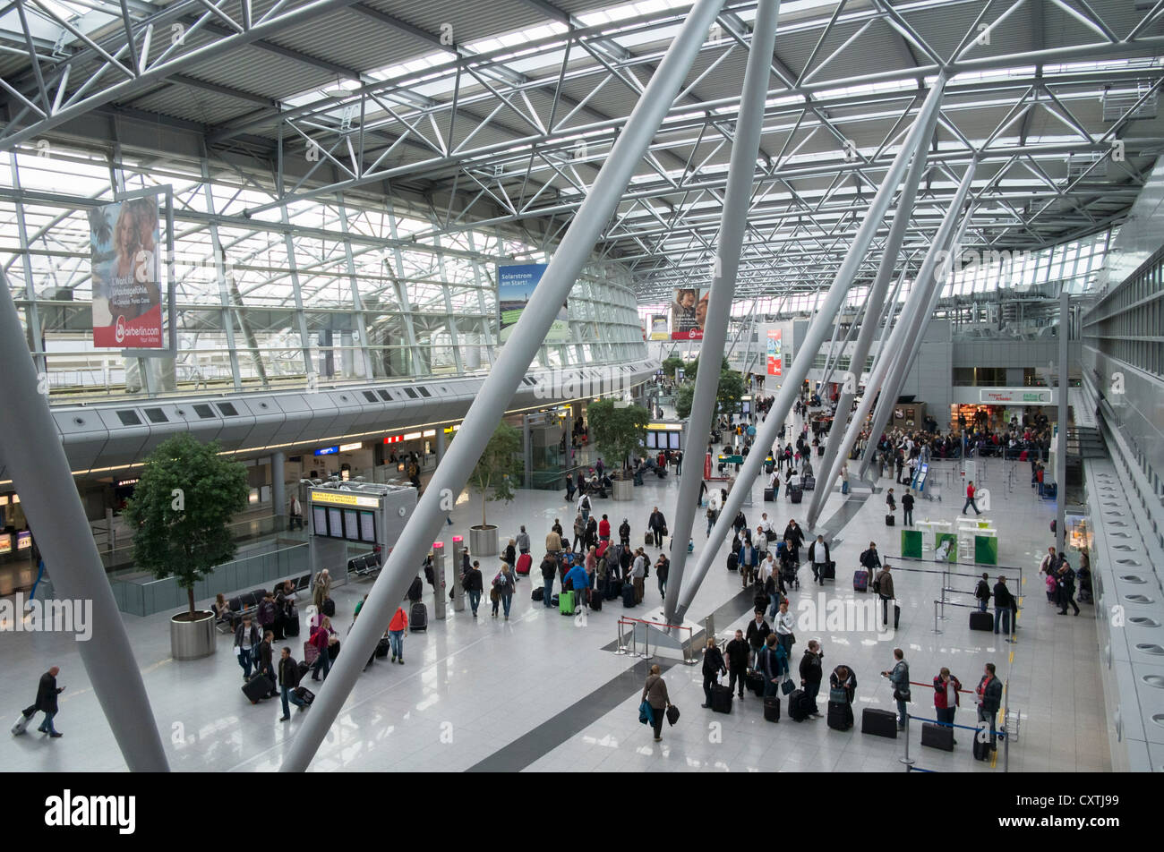 Interior of passenger Terminal building at Dusseldorf International airport in Germany - Stock Image