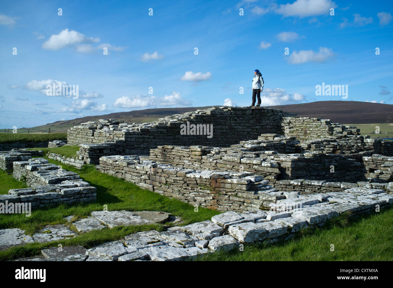 dh Cubbie Roos Castle WYRE ORKNEY Tourist woman Viking ruins uk people scotland holiday norse archaeology Stock Photo