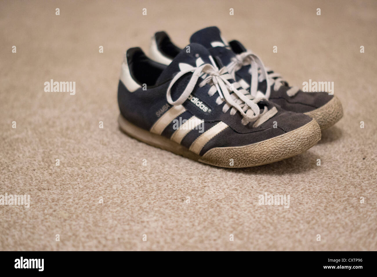 Old Adidas blue Samba trainers Stock Photo - Alamy