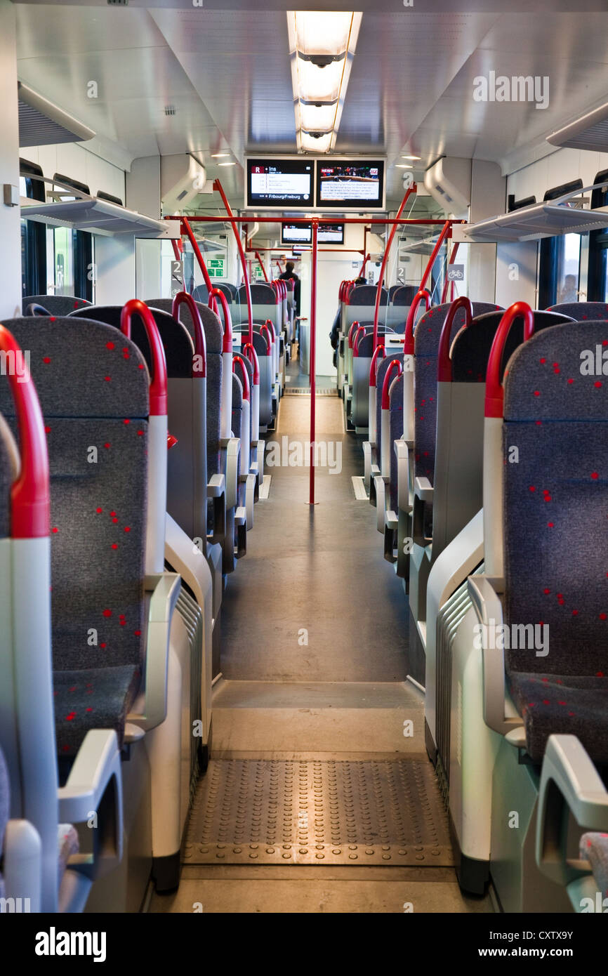 Interior view of a Swiss regional train waiting for passengers at the station of Ins, Switzerland - Stock Image