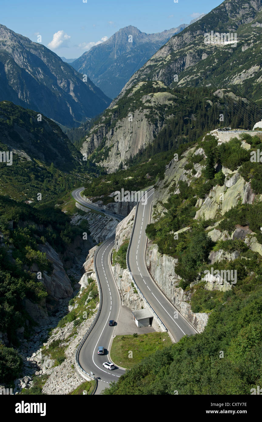 Hairpin bends on a mountain road near the Grimsel Pass, Grimsel Region, Switzerland - Stock Image