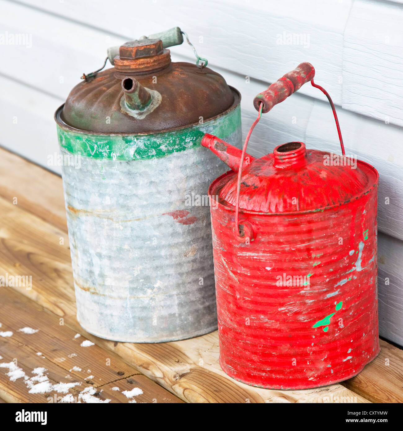 A pair of old antique oil cans made of tin. Originally made for kerosene or stove oil. - Stock Image