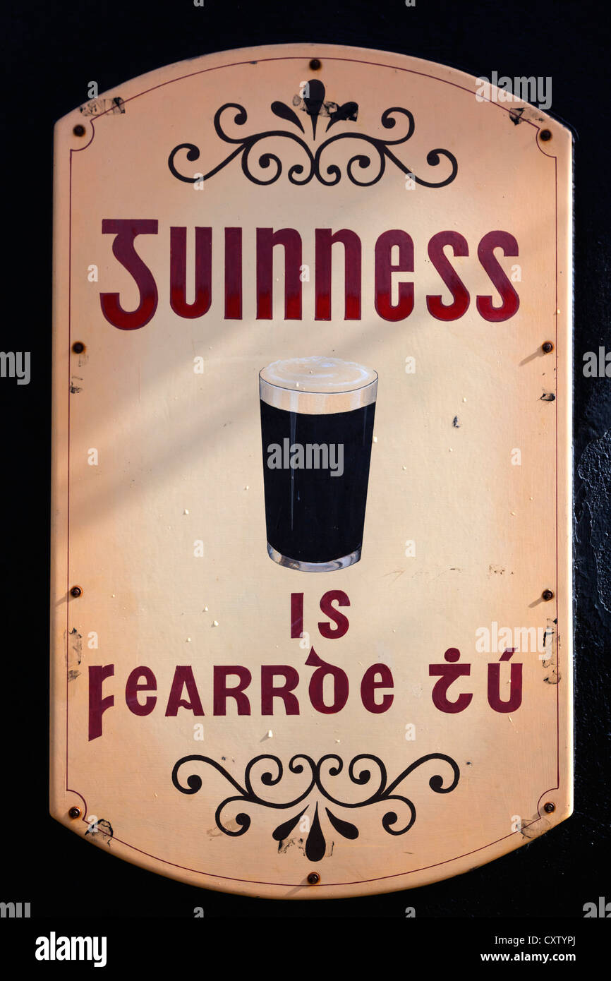 Sign in Irish for Guinness stout. The slogan translates as You Are the Better for Guinness, or Guinness is Good - Stock Image