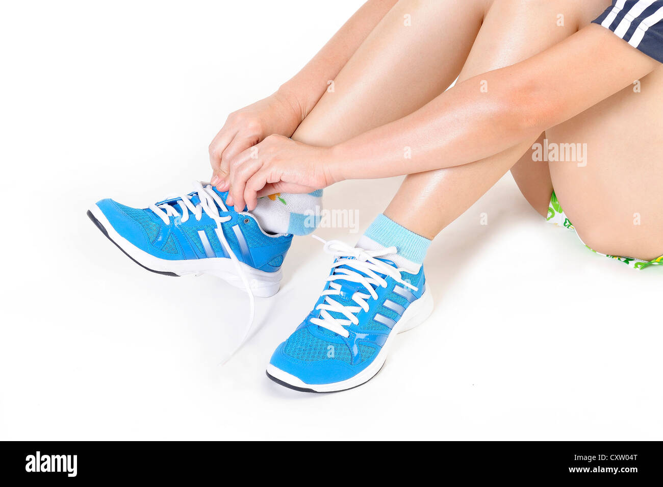 Athlete girl trying running shoes - Stock Image