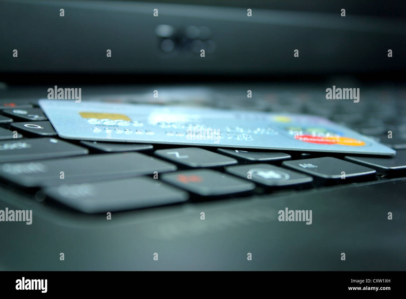 Credit card on the keyboard - Stock Image