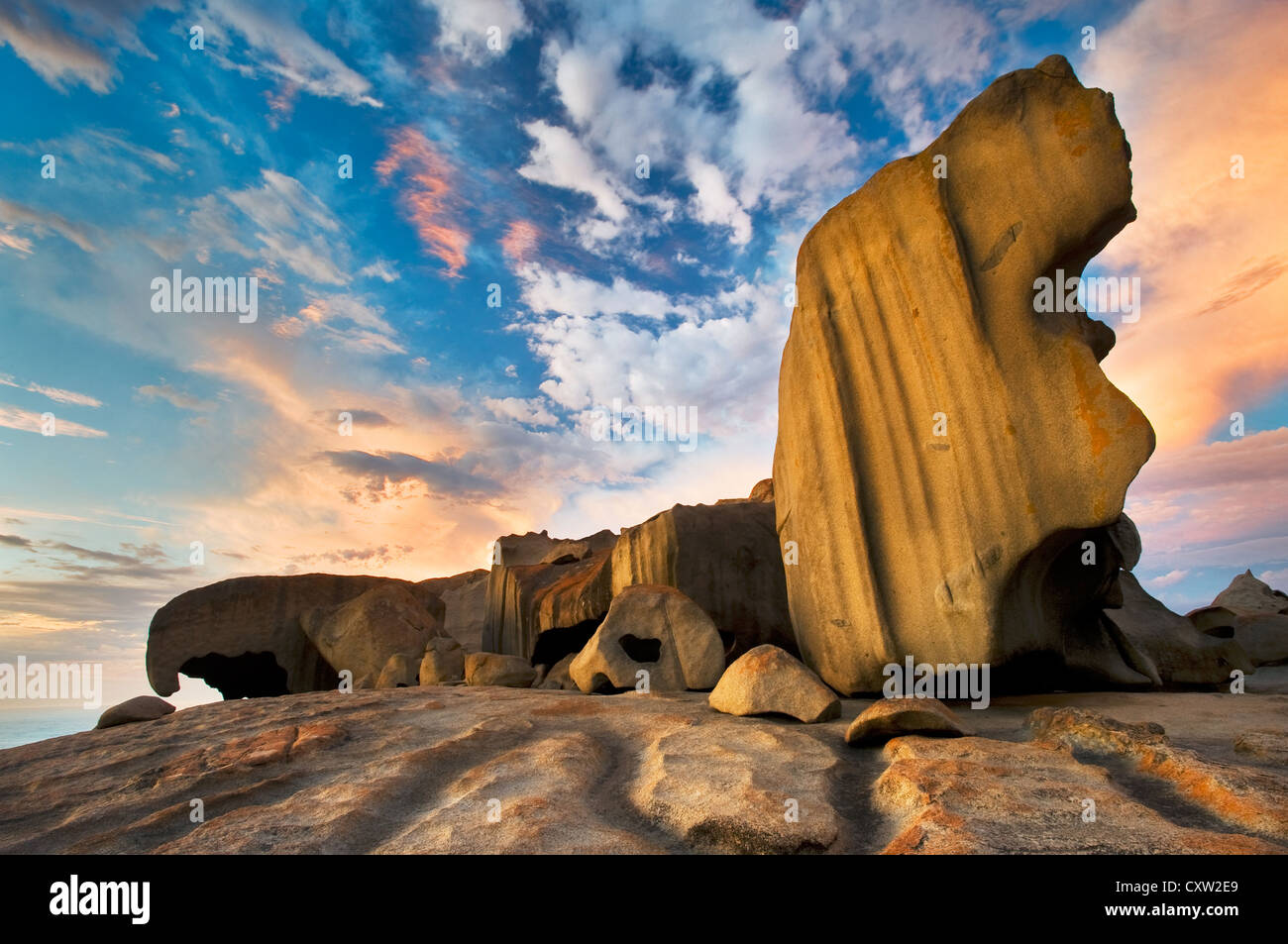 Remarkable Rocks under colourful clouds at sunrise. - Stock Image