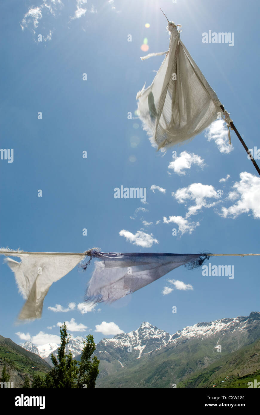 Prayer flags flutter in the breeze in the Himalayan town of Keylong, India - Stock Image
