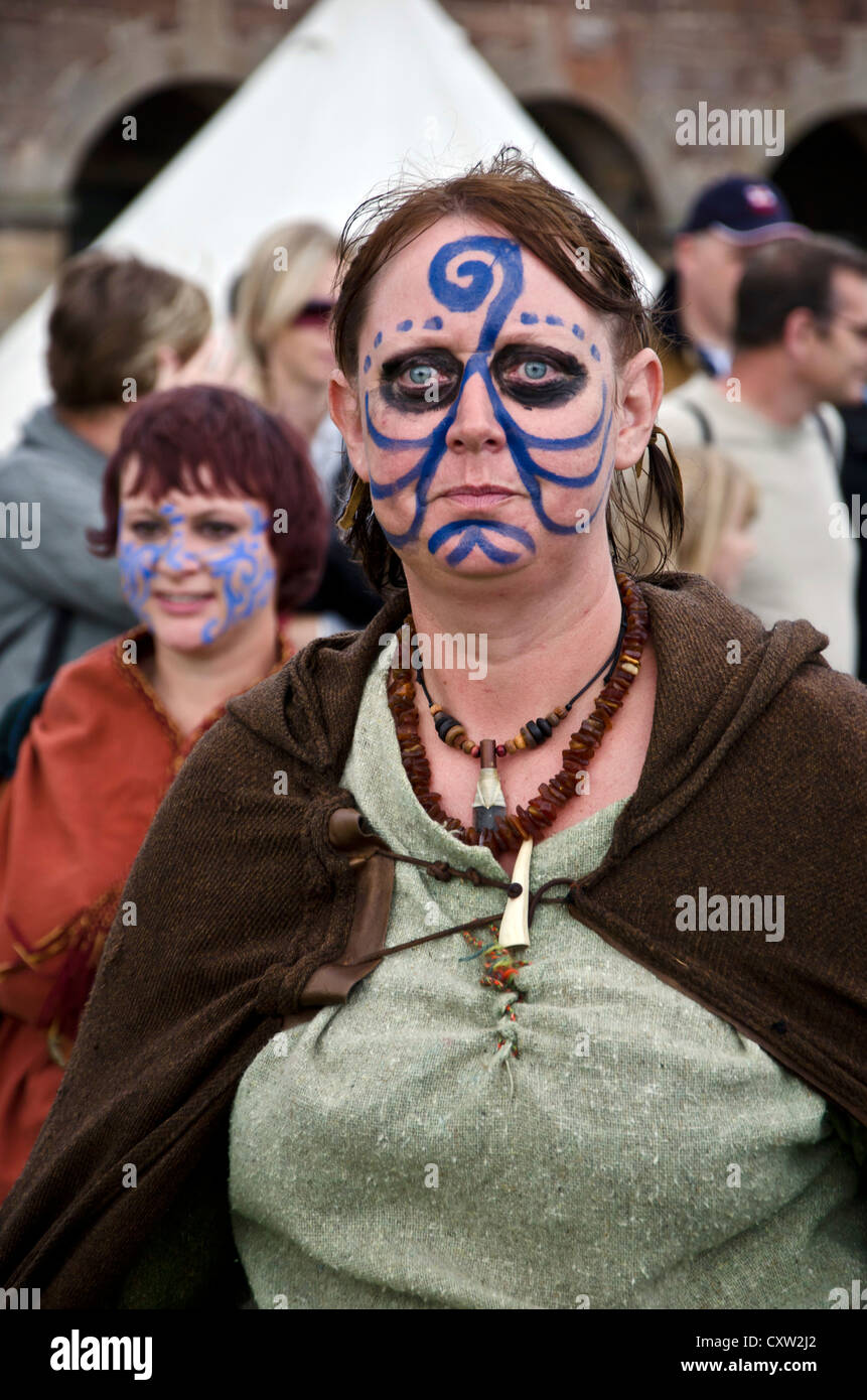 Woman with viking face decoration at an historic event at Fort George near Inverness, Scotland. - Stock Image