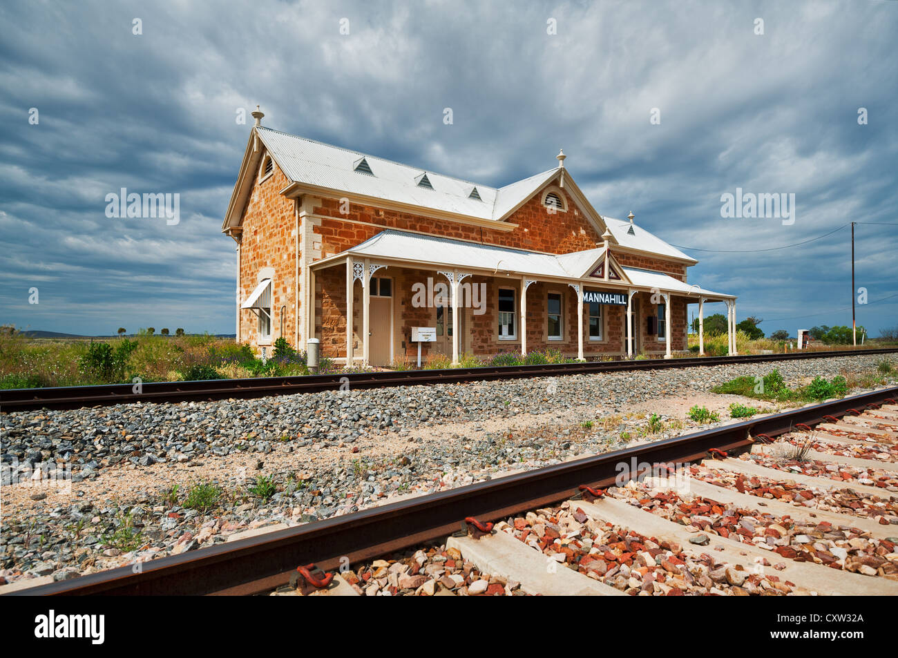 Old Mannahill Railway Station under dark clouds - Stock Image