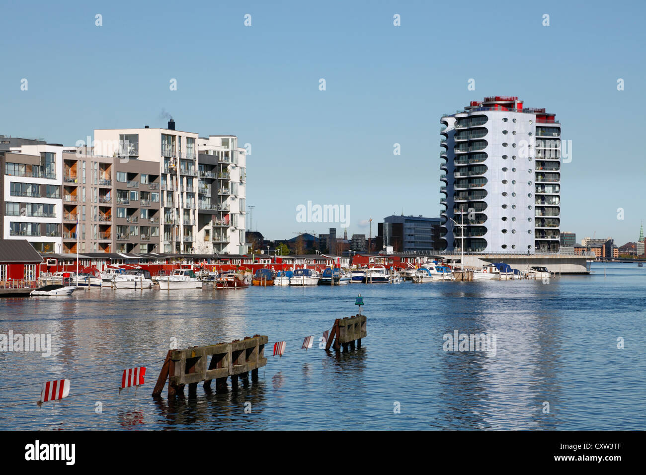 Apartment blocks and the Metropolis block of condos to the right on Sluseholmen in modern environment in the south - Stock Image