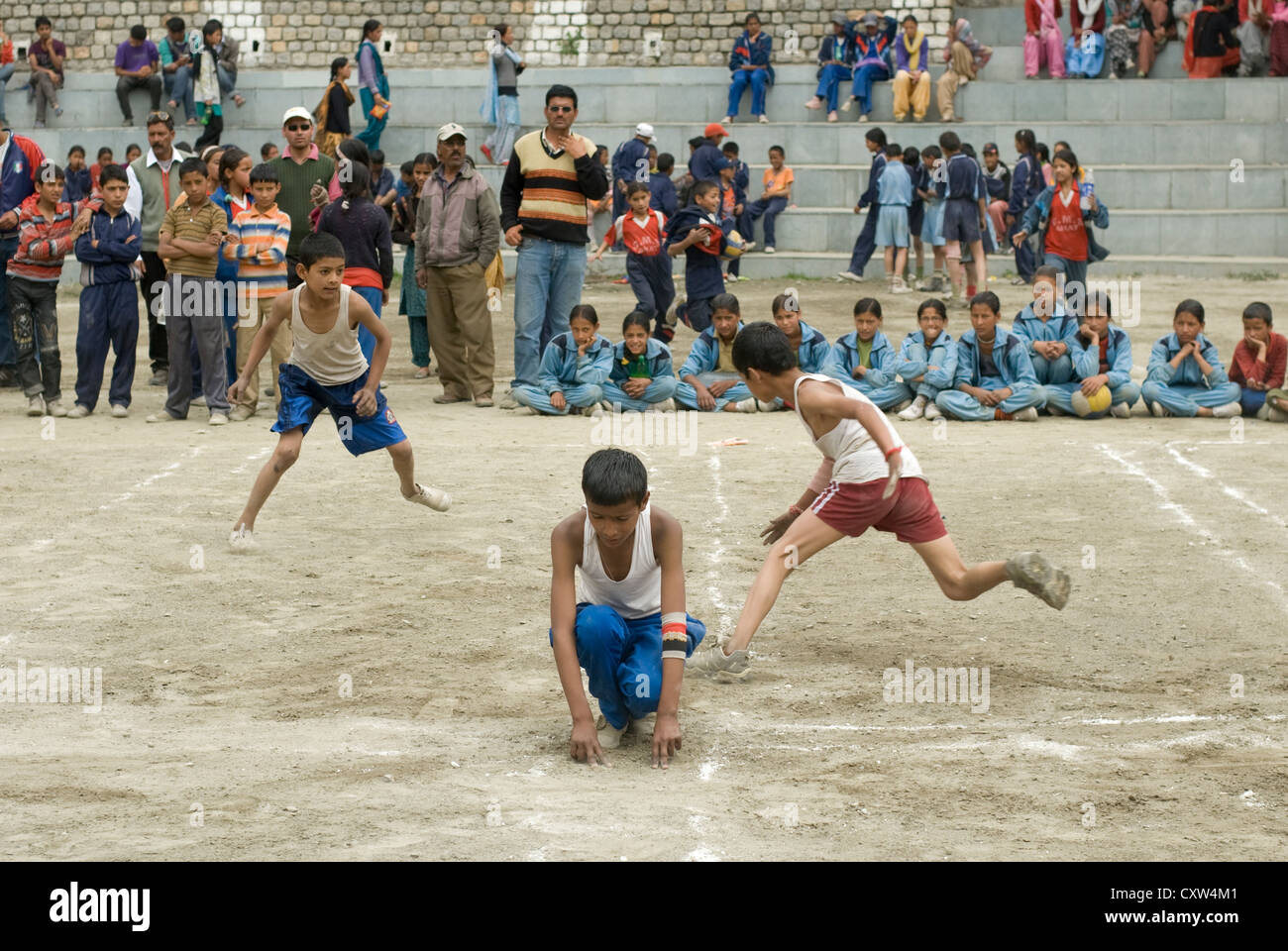 Boys from different schools compete at 'Kho Kho' in Keylong, North India - Stock Image