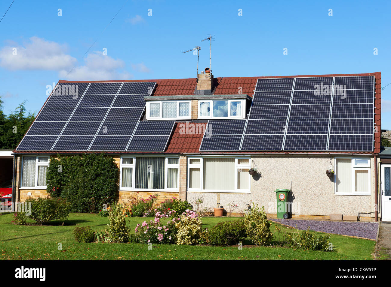 Semi detached dorma bungalows with solar panels on the roof Hilmorton Road Rugby UK - Stock Image