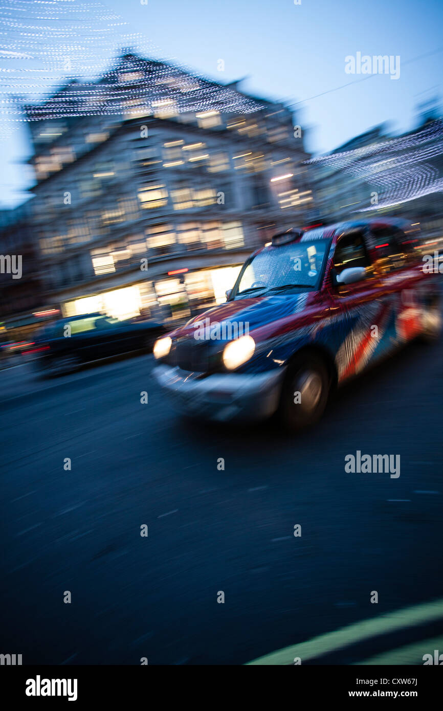 Motion Blur shot of a London Cab - Stock Image