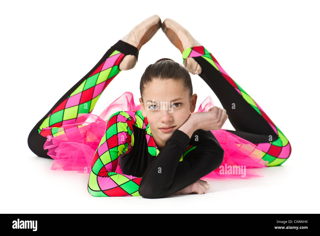 Teenage ballerina in modern multi-coloured harlequin-pattern ballet costume with pink netting - Stock Image