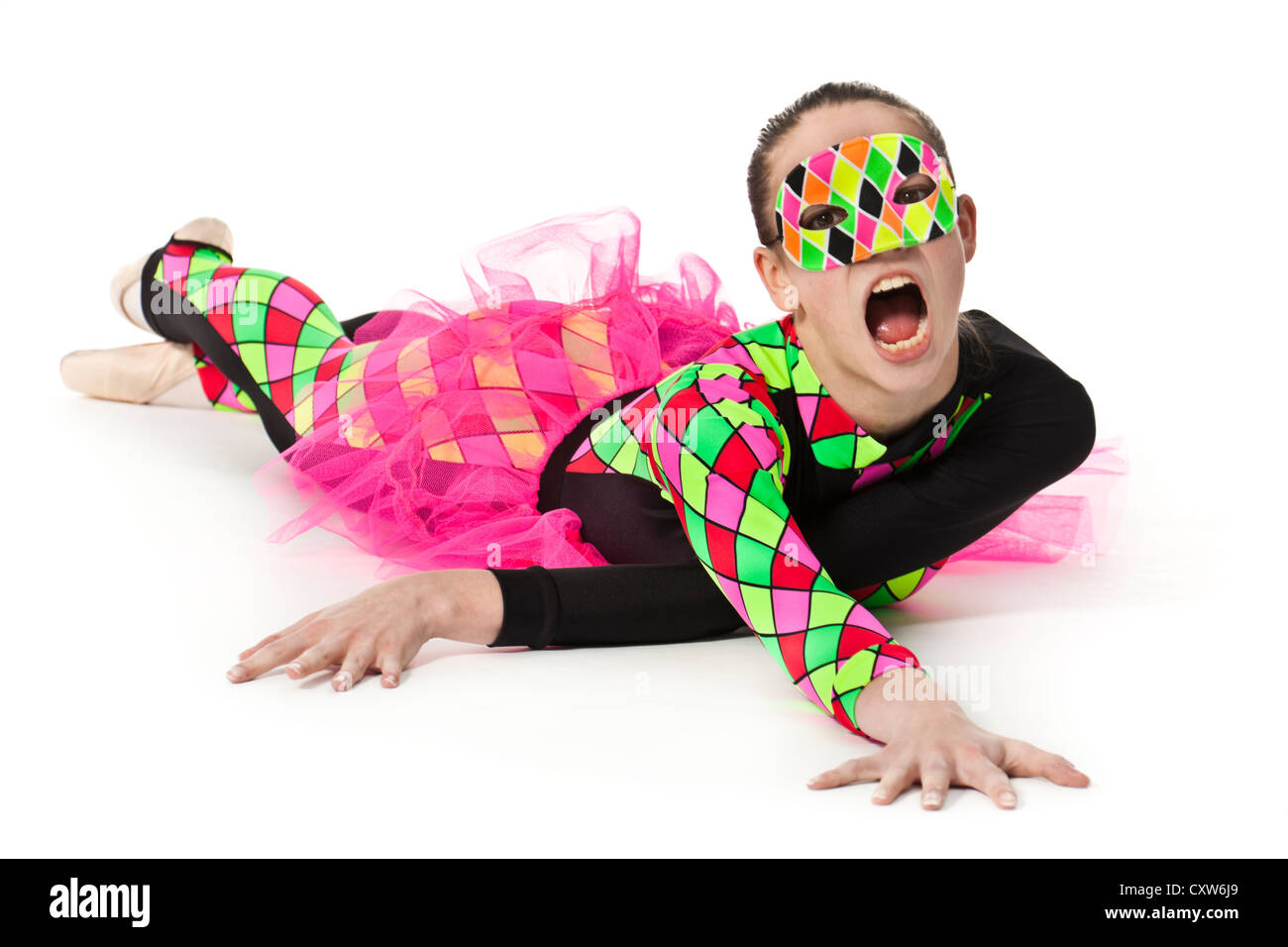 Teenage ballerina in modern multi-coloured harlequin-pattern ballet costume with pink netting and wearing a matching - Stock Image