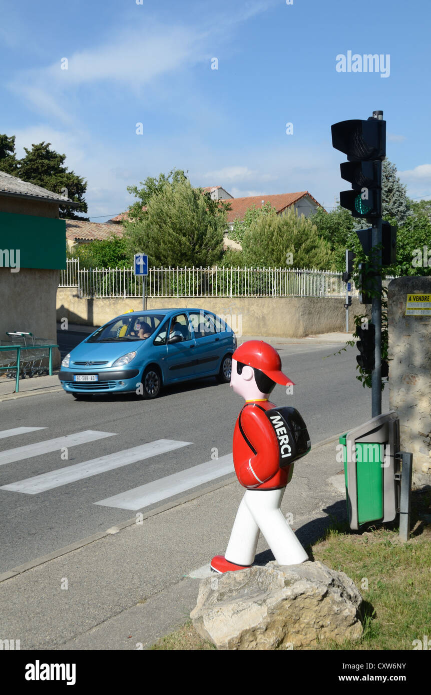 Boy or Schoolboy Model Crossing Pedestrian Crossing and Traffic Lights Provence France - Stock Image