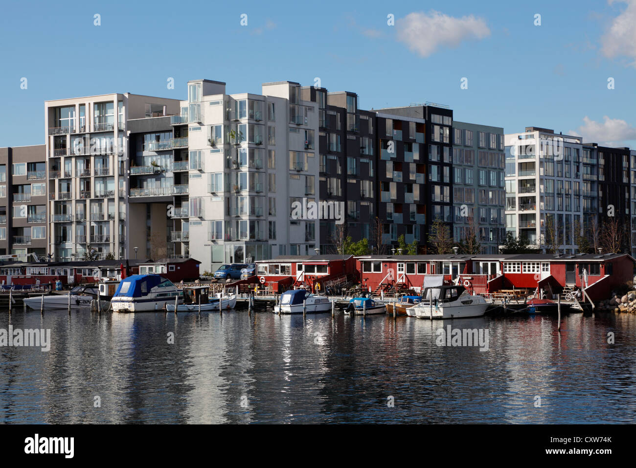 Modern residential buildings with Venice-like canals between the buildings on Sluseholmen in Copenhagen, a former - Stock Image
