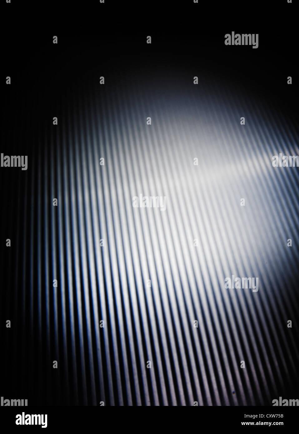 Metallic background ridged spotlit - Stock Image