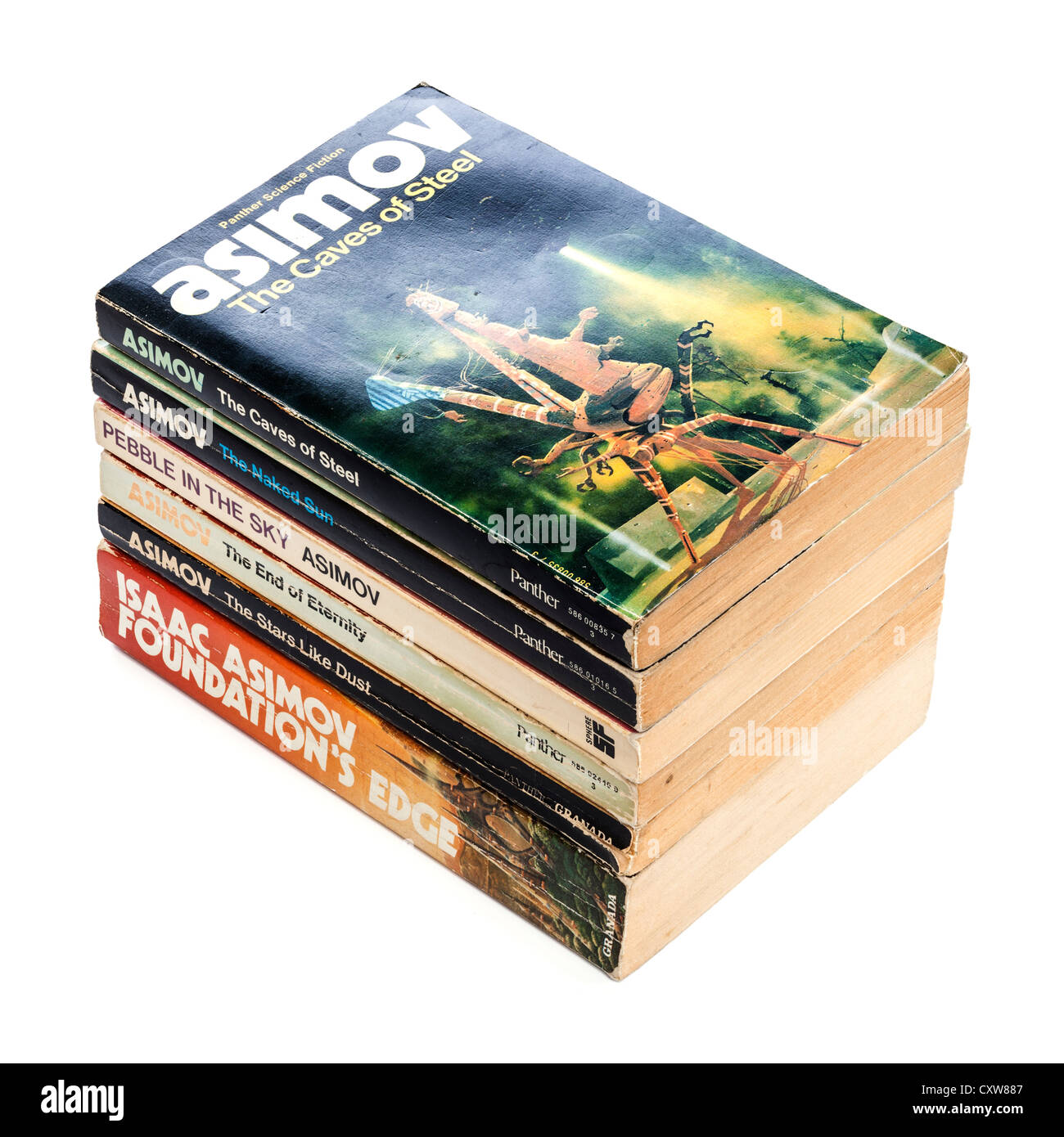 A stack of Science Fiction paperbacks by Isaac Asimov, on a white background with soft natural shadow. - Stock Image