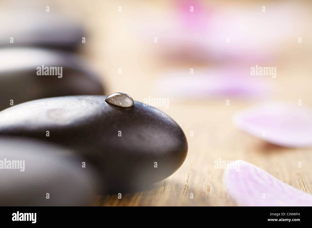 Spa stones set on the wooden table - Stock Image