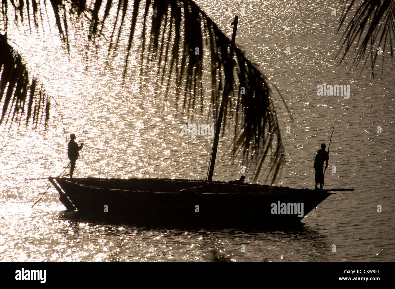 This silhouette style picture of  a dhow was taken early morning in Mocimboa da Praia, Mozambique. - Stock Image