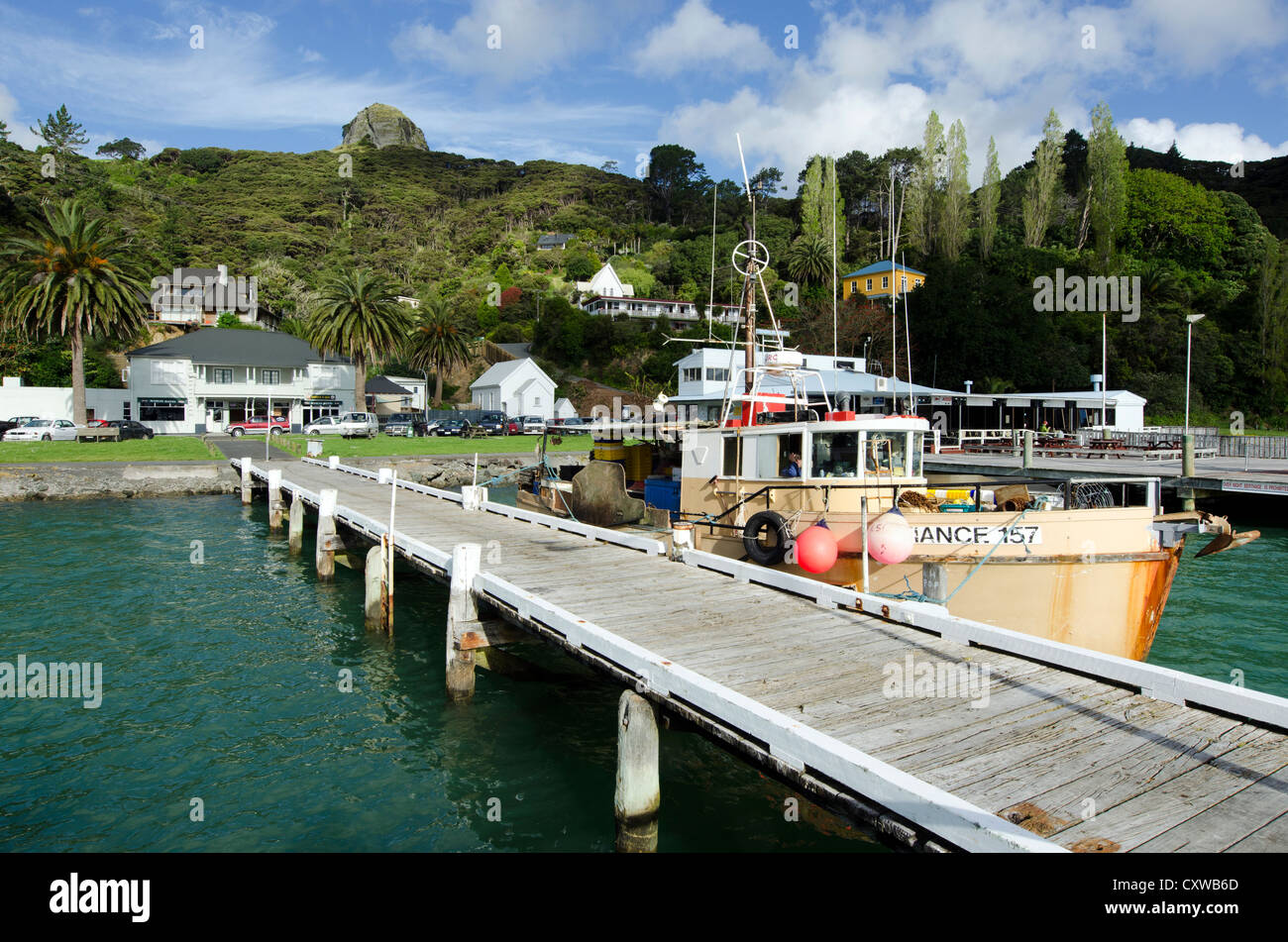 Landscape of an old fishing boat Whangaroa harbor during sunset in Northland, New Zealand. - Stock Image