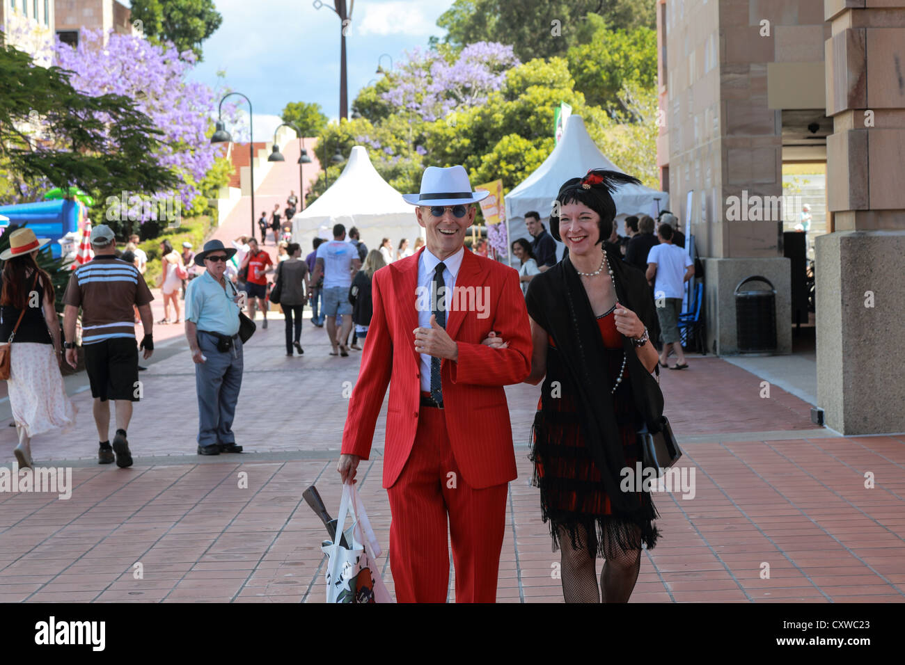 A couple dressed in a 1920s' style at themed event at Bond University festival - Stock Image