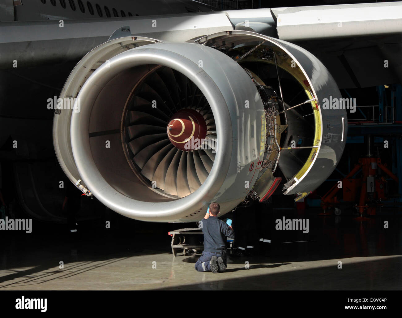 Rolls-Royce Trent 500 jet engine on an Airbus A340-600 airliner undergoing maintenance. Aviation engineering, high - Stock Image