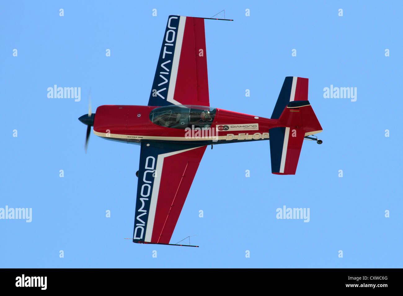 Extra 200 light aerobatic and racing plane during an air display - Stock Image