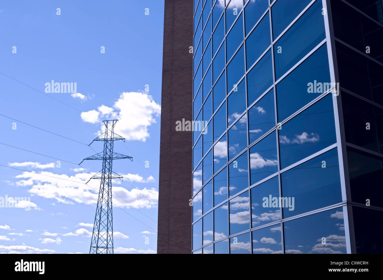 Architecture abstract of windows reflecting clouds and blue sky next