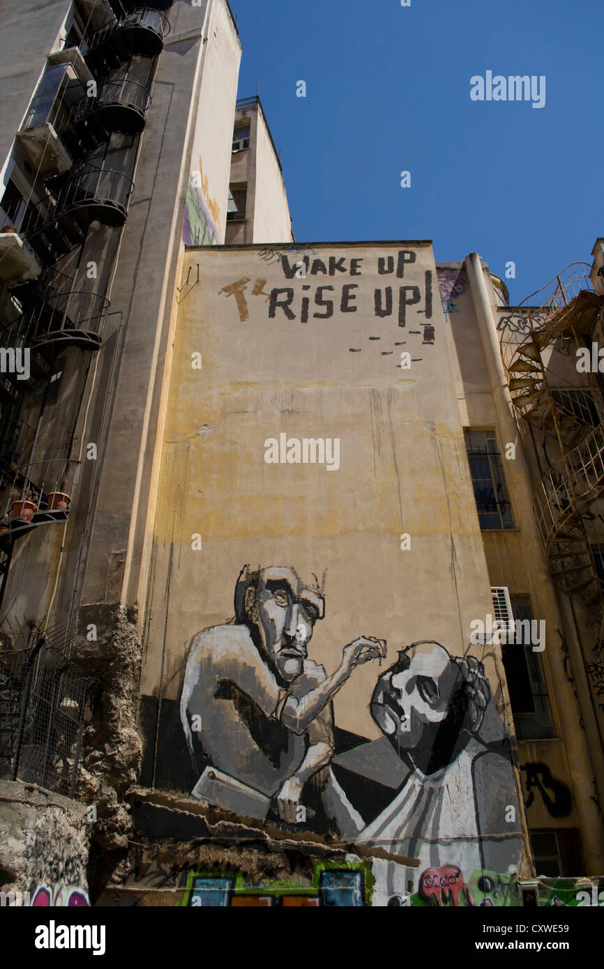 A mural reads, 'Wake up, rise up'. - Stock Image