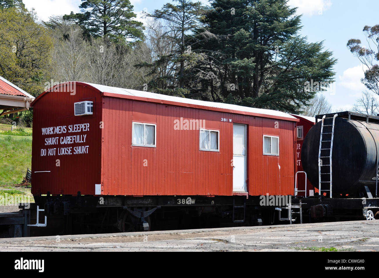 Vintage red workmen's sleeper car in Daylesford, Central Victoria, Australia - Stock Image