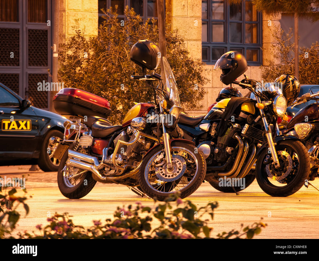 Sight on several motorcycles parked on the town square. - Stock Image