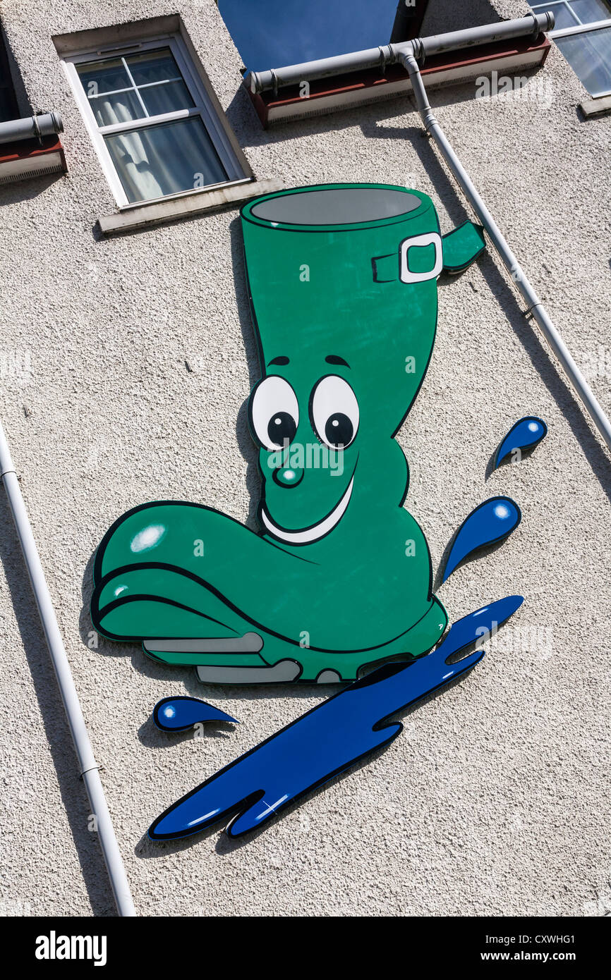 Green Wellington boot logo on the wall of the Green Welly Stop, Argyll & Bute, Scotland. Stock Photo