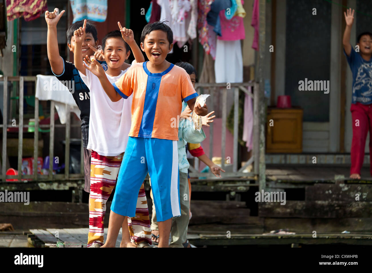 Joyful Children playing at the Canals in Banjarmasin, Indonesia - Stock  Image
